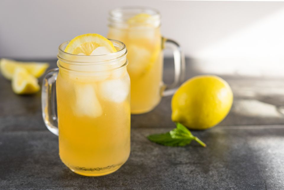 Lynchburg lemonade in mason jars on a dark tabletop