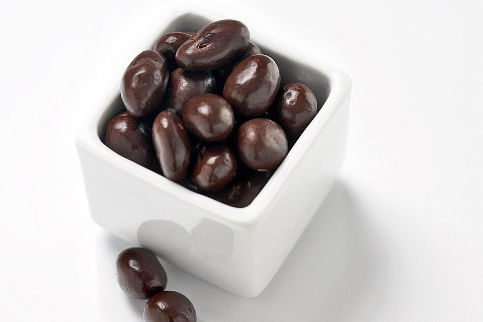 A small box of chocolate-covered raisins