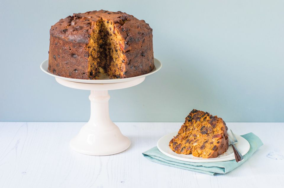 Traditional British fruitcake on a stand and on a plate