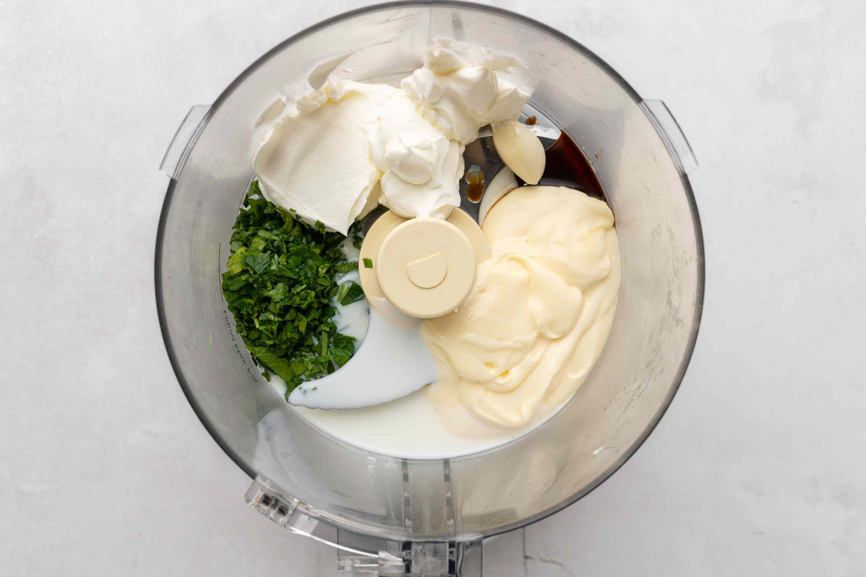 mayonnaise, sour cream, parsley, Worcestershire sauce, buttermilk, lemon juice, and garlic in a food processor