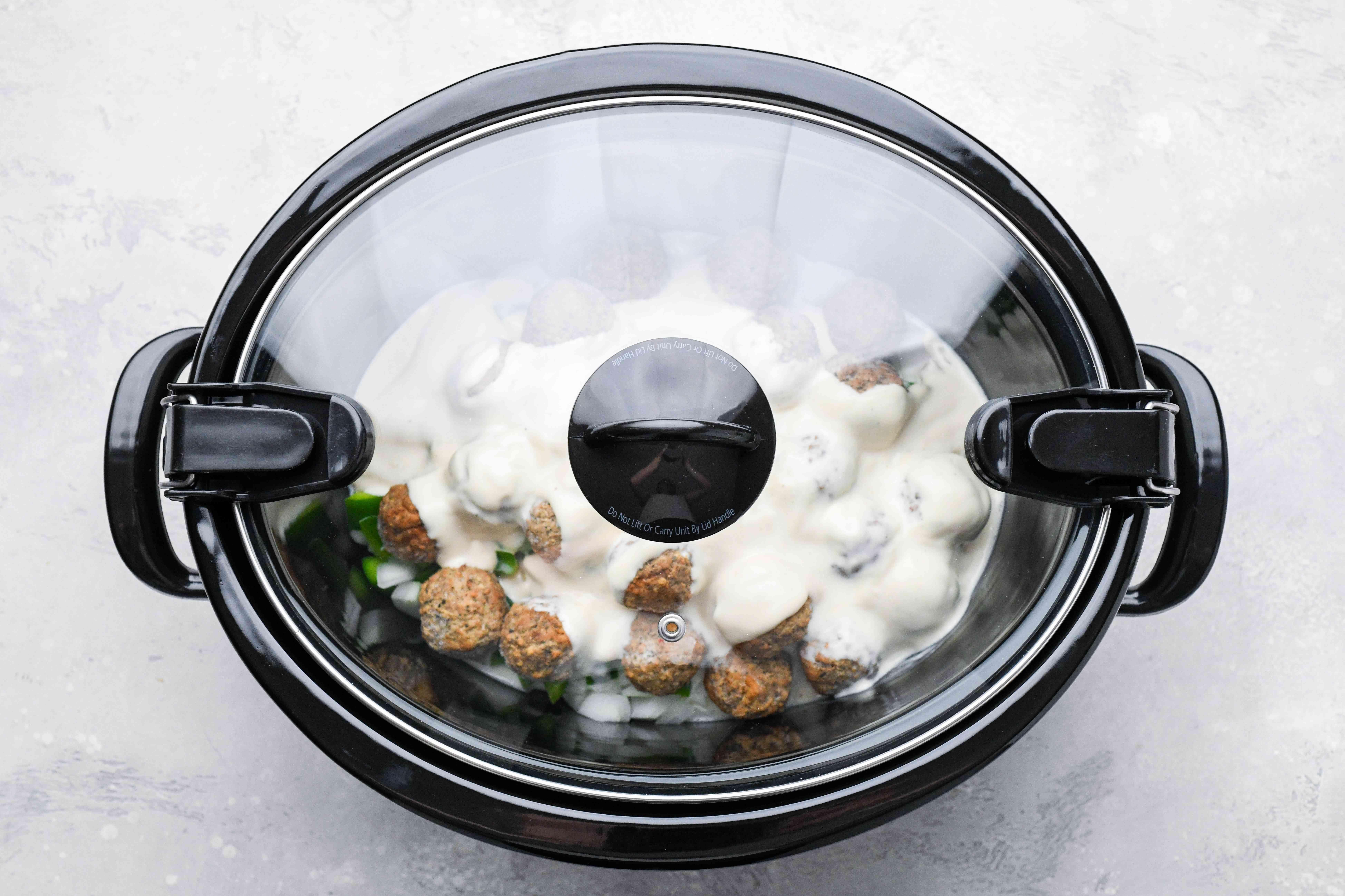 Creamy Pesto Meatballs in a slow cooker
