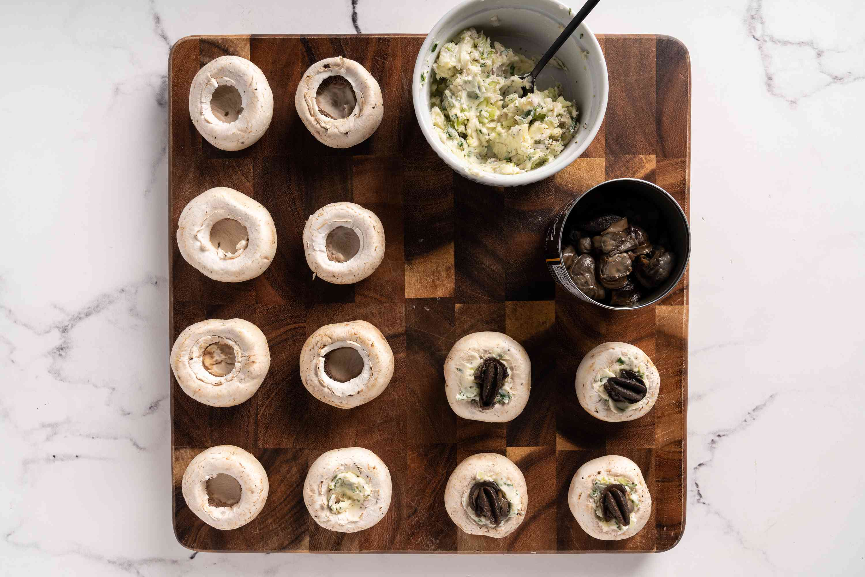 mushroom caps stuffed with butter mixture with escargot on top