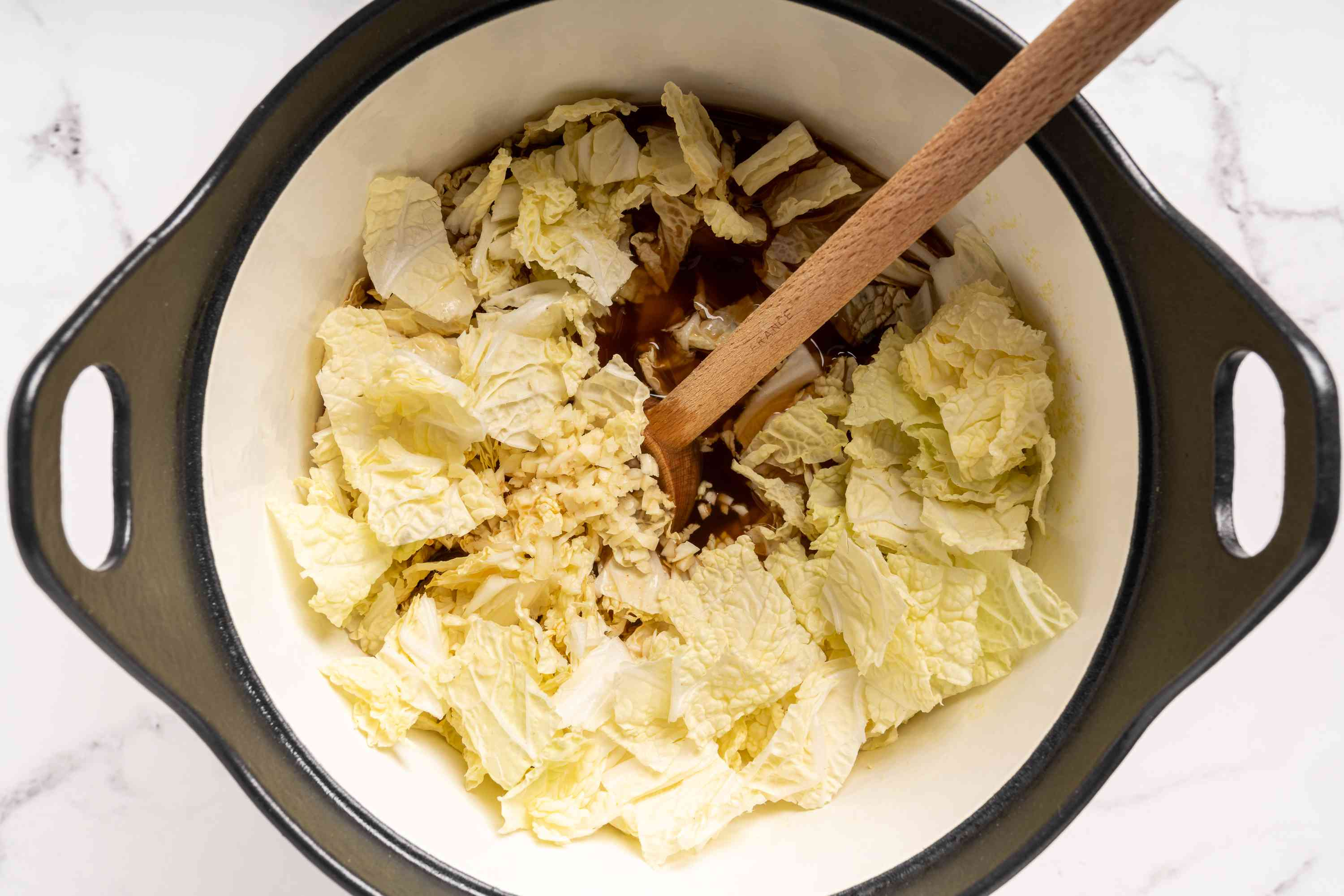 add cabbage and garlic to the sauce in the pot