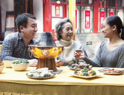 family enjoying hot pot