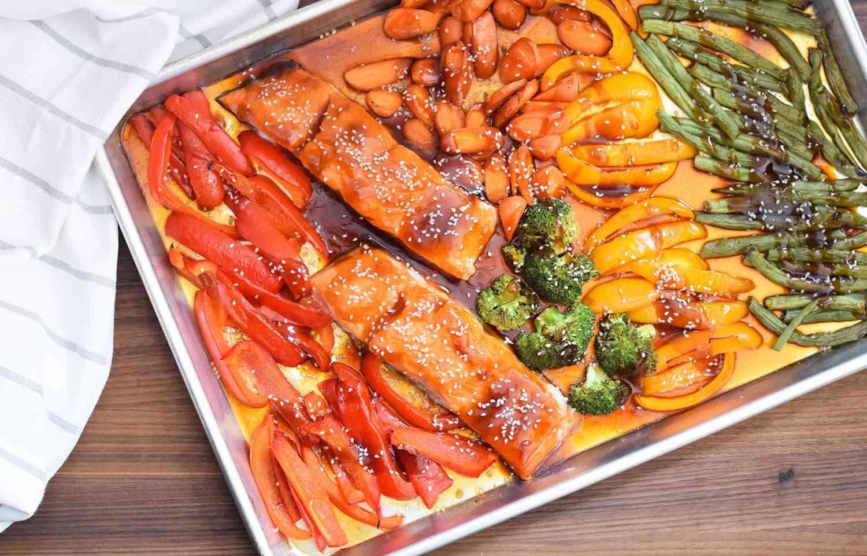Sesame seeds sprinkled on top of salmon teriyaki and vegetables