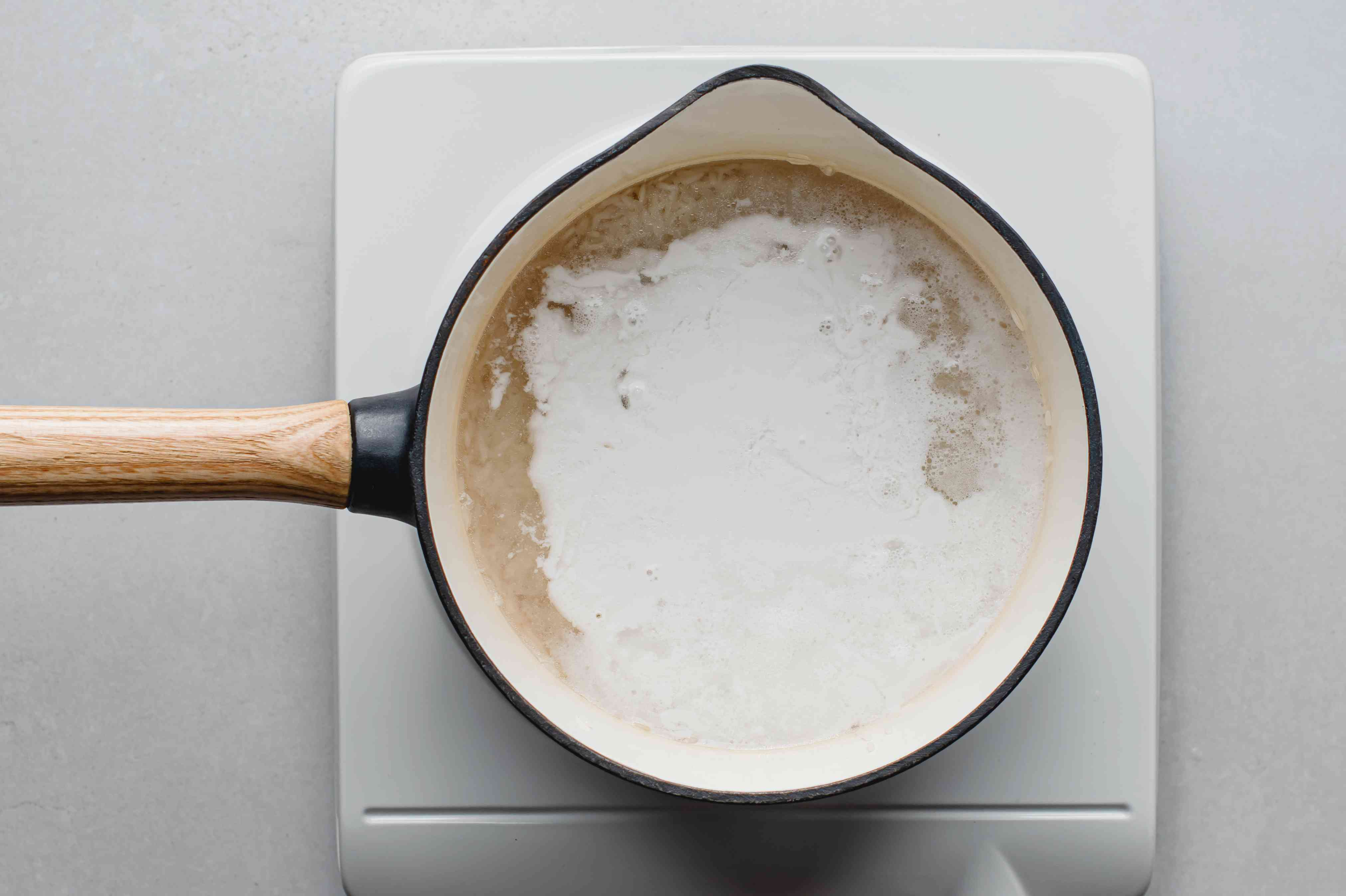 rice, coconut milk and water in a saucepan