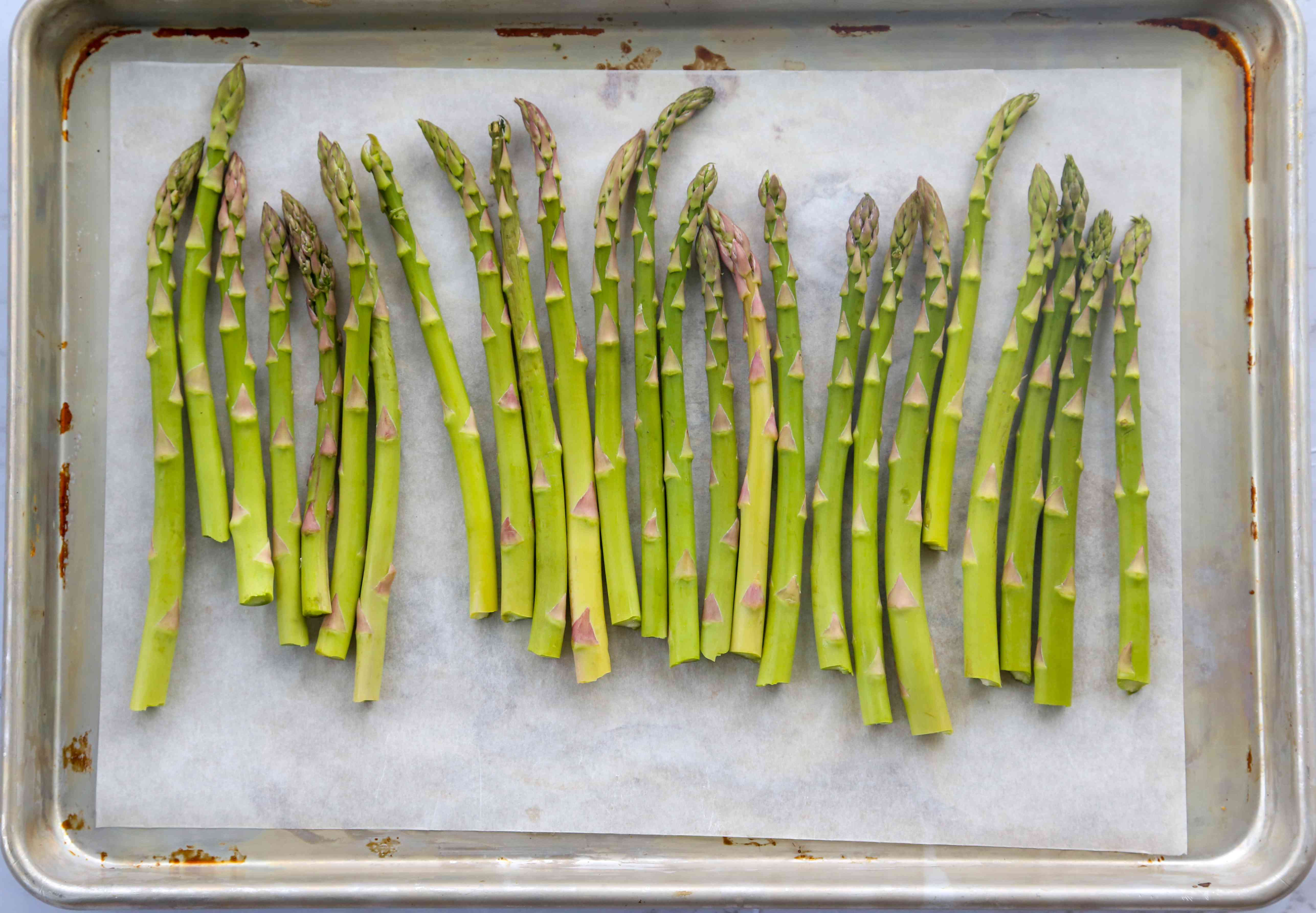 Lay the asparagus spears in a single layer in a baking dish