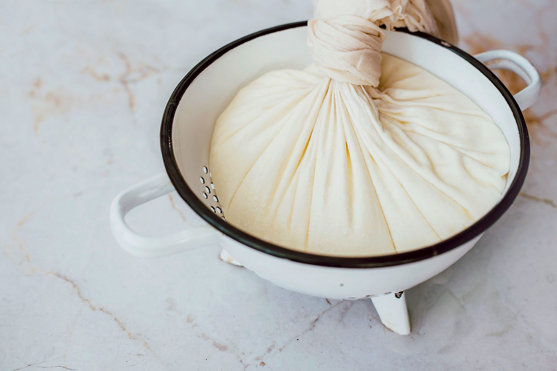 tie the muslin into a tight knot with the curd inside