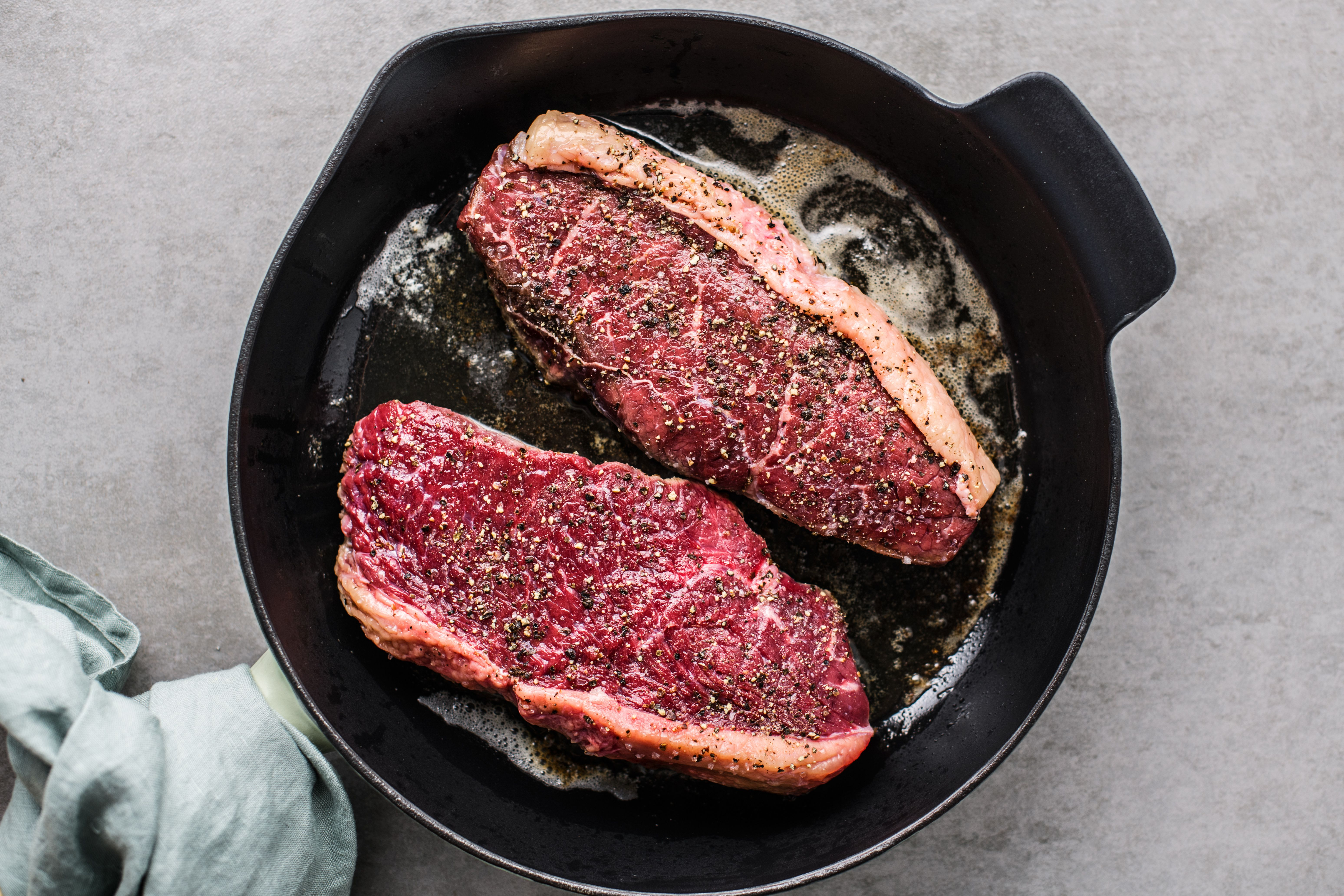 Steaks in a hot pan with butter and oil