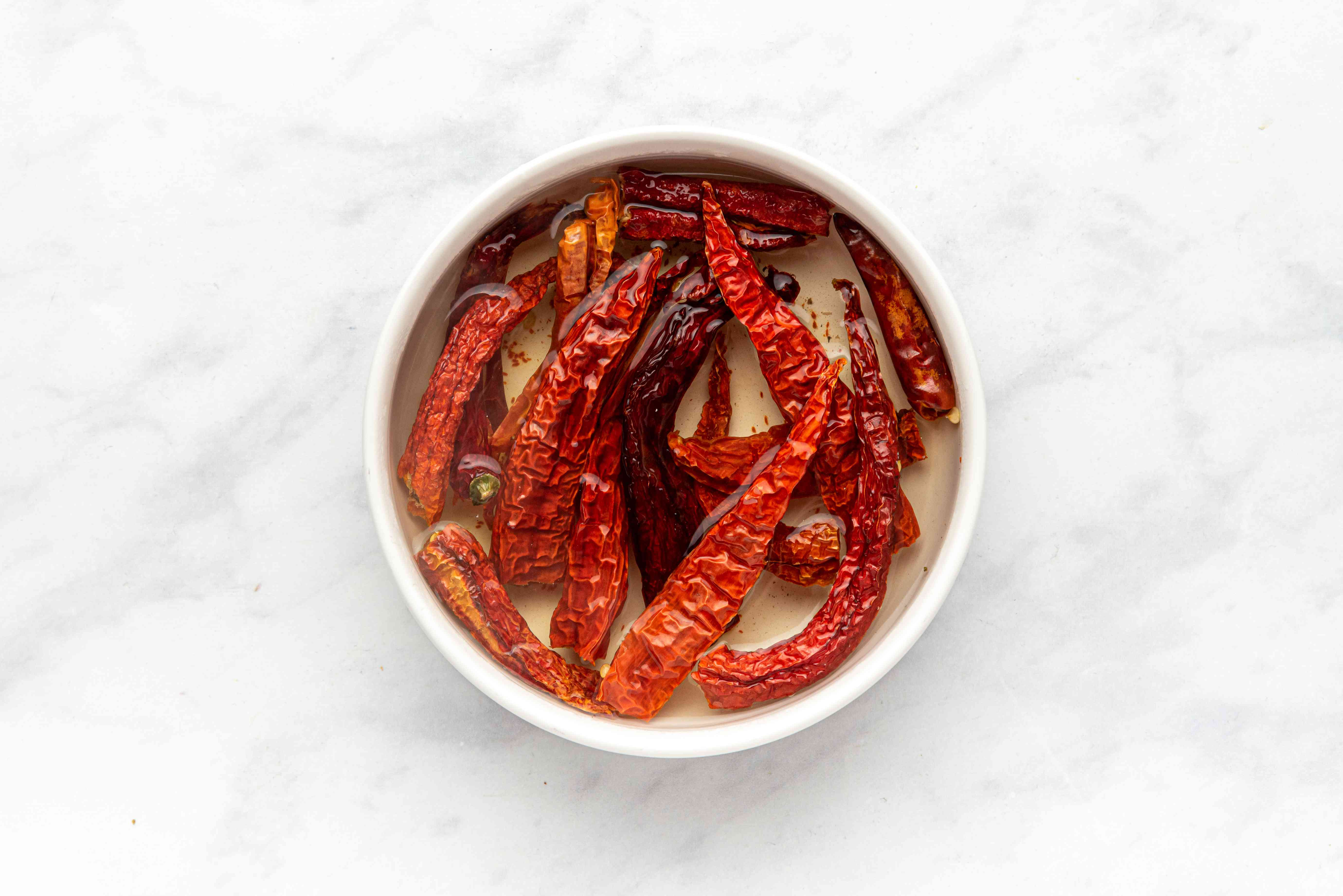 Soak the dried chilies in hot water