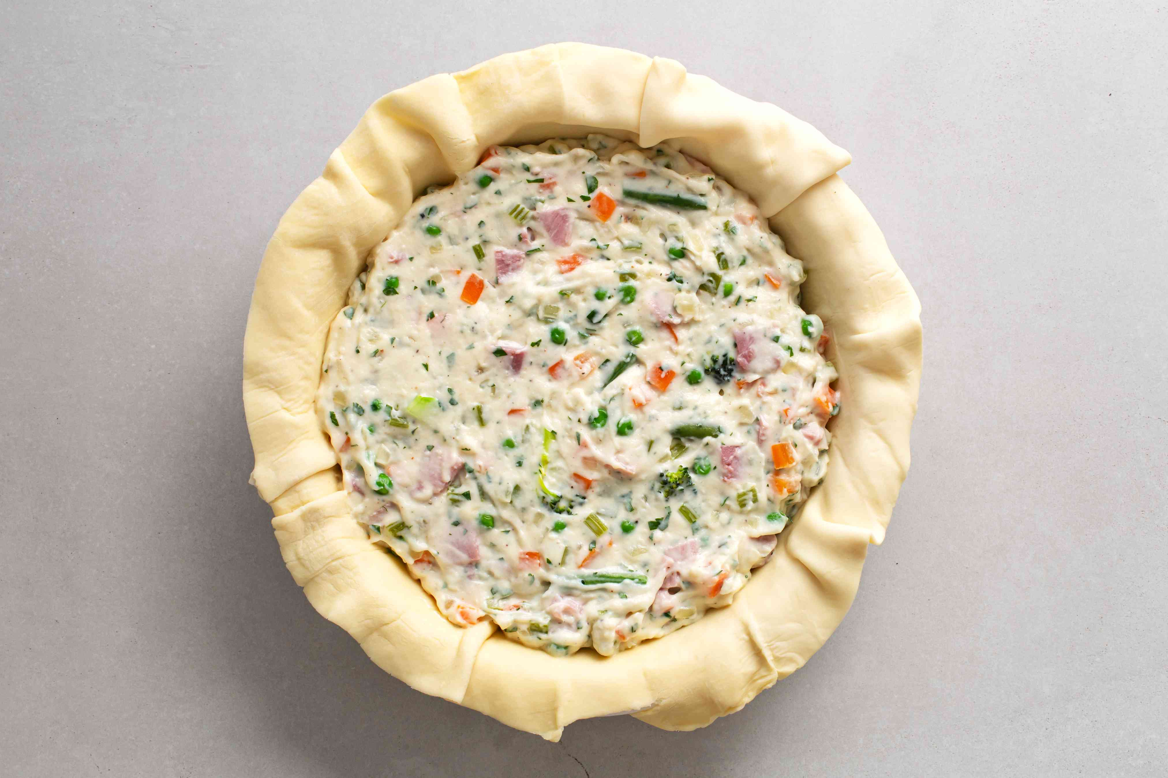 ham mixture in a pie tin line with dough