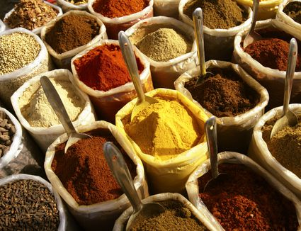 Spices in containers at market