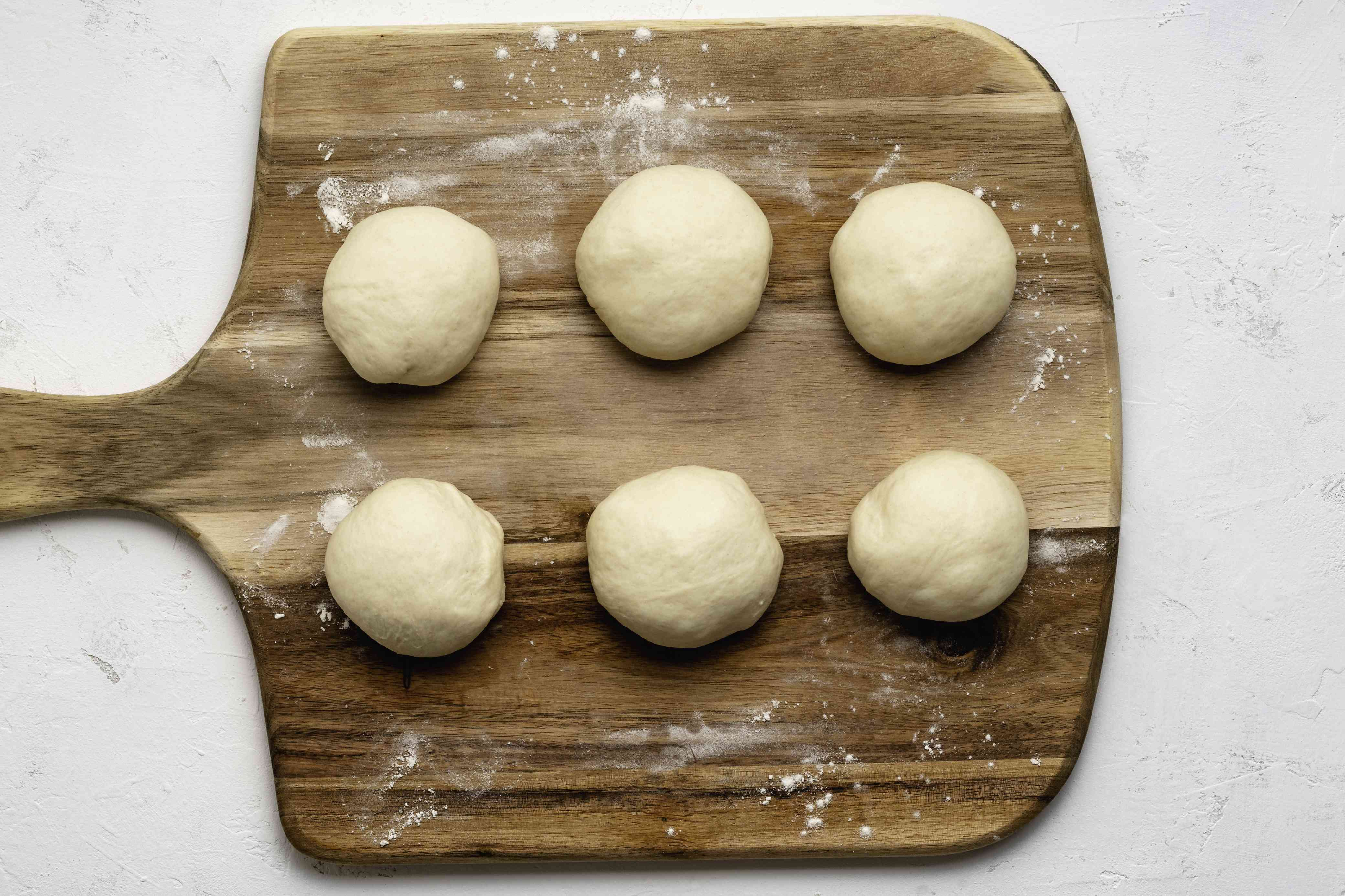 Dough divided into six equal rounds