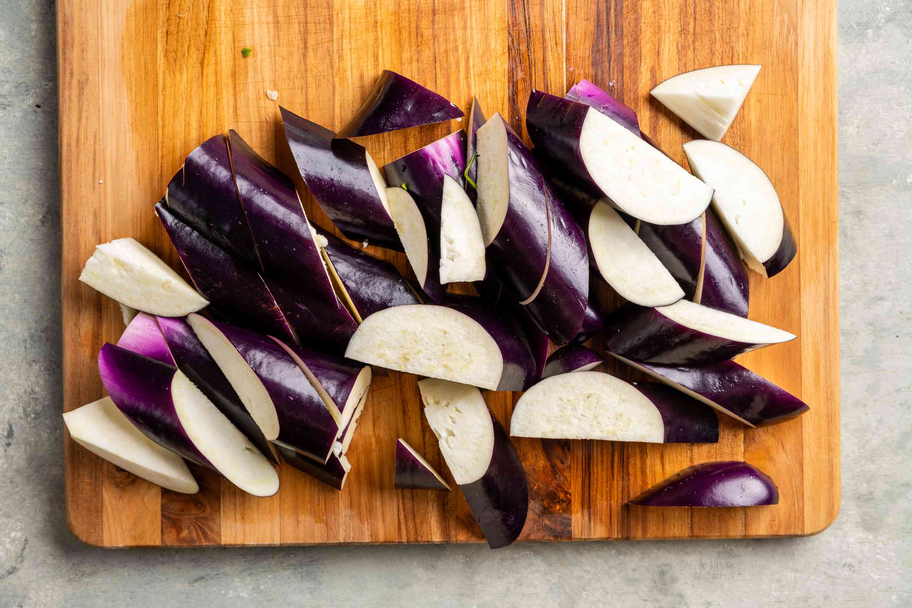 Line up the eggplant slices from left to right and cut diagonally into pieces