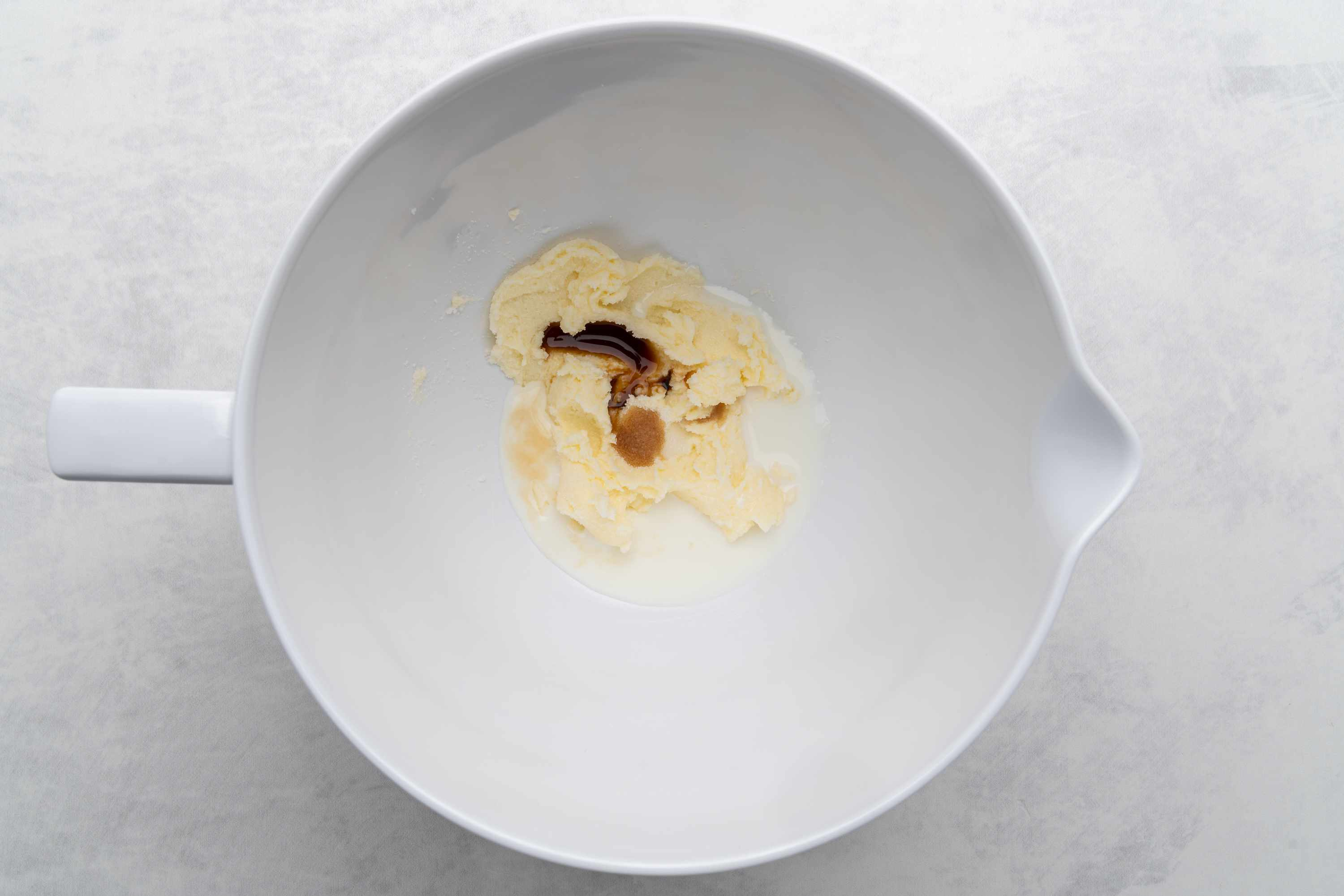 butter with vanilla and milk in bowl