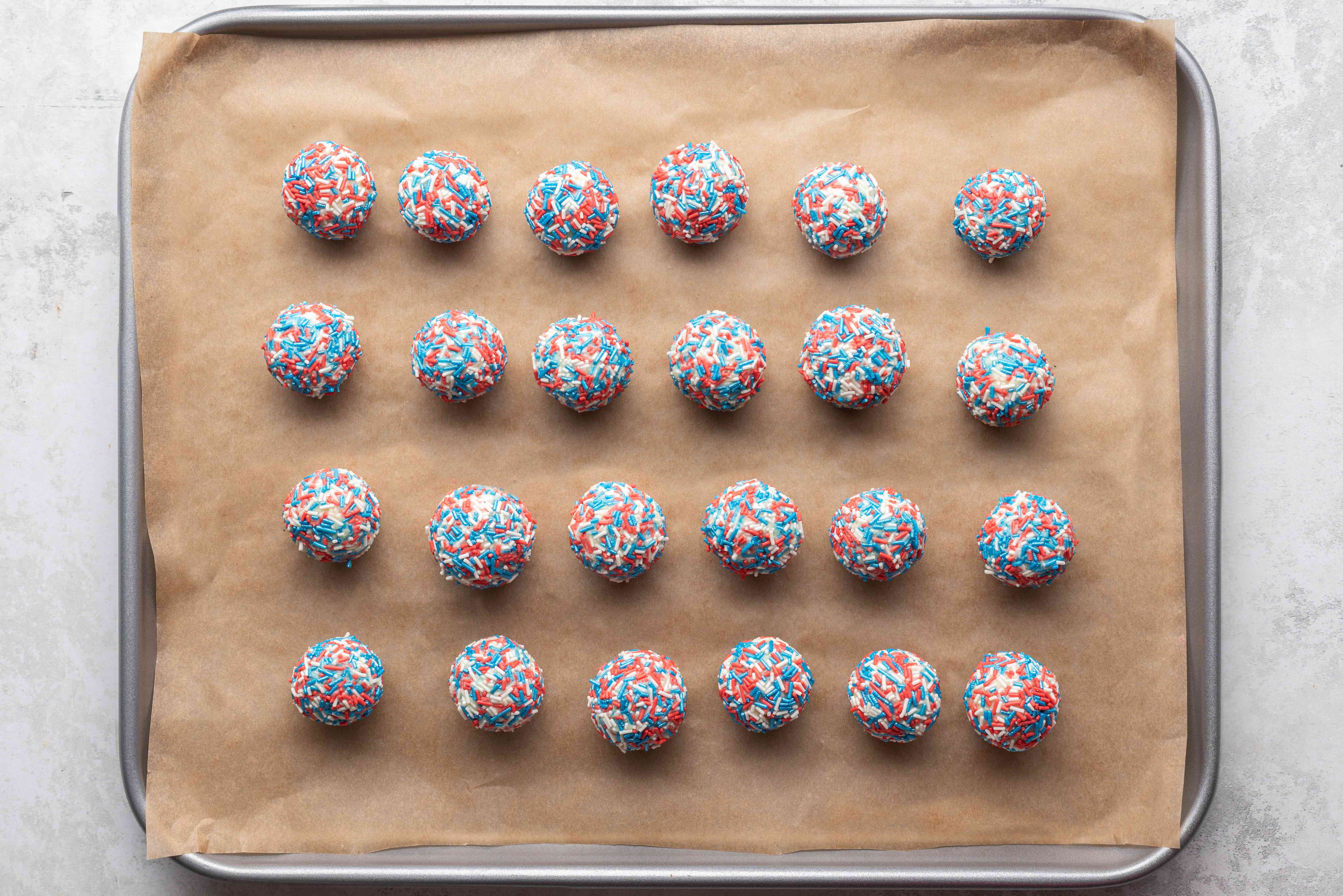 Red, White, and Blue Truffles on a parchment paper lined baking sheet