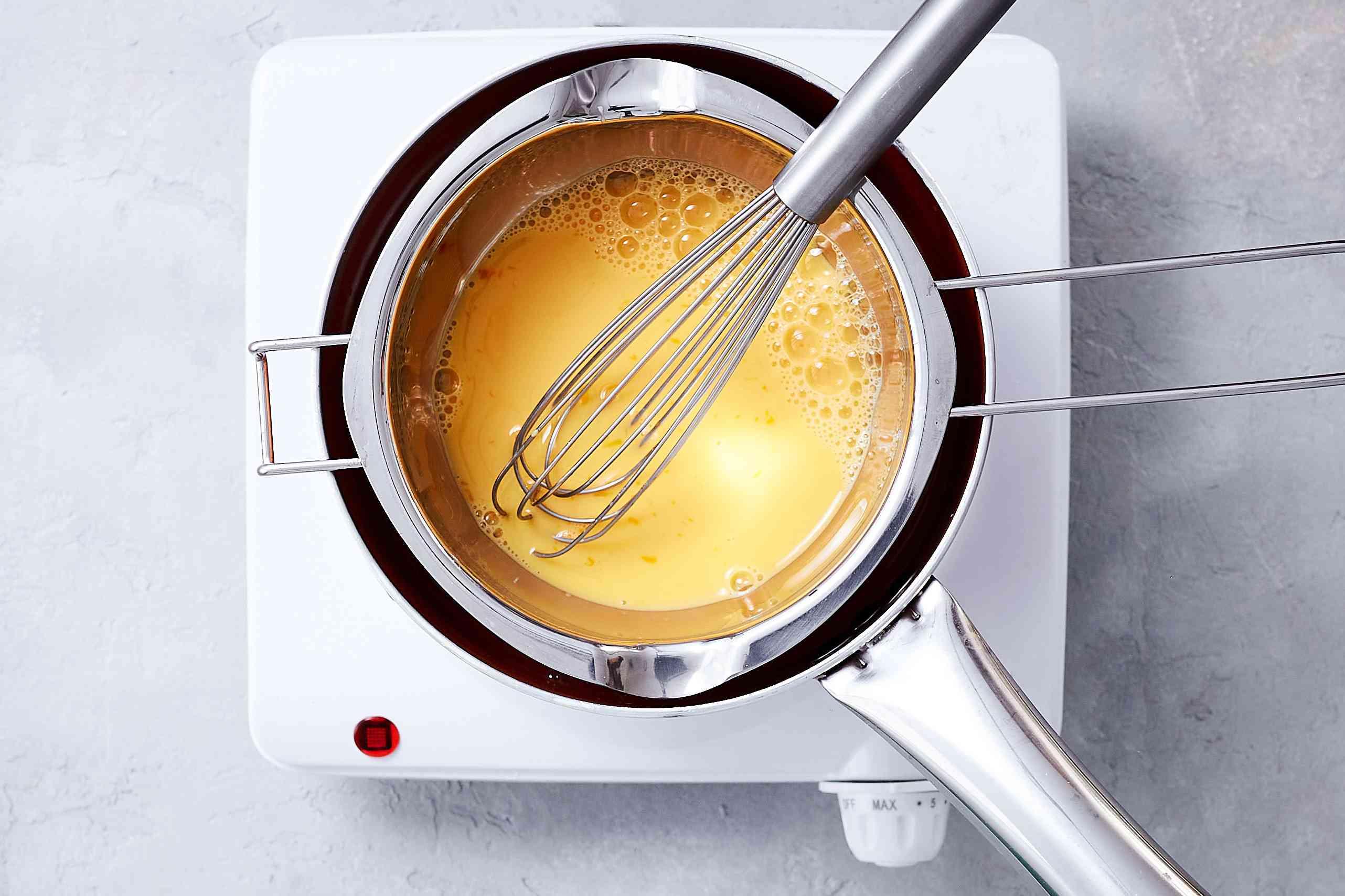Whisk egg yolks into a double boiler