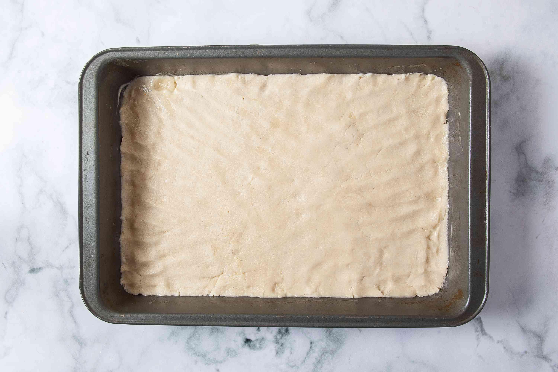 Meyer Lemon Bar crust pressed into the baking pan
