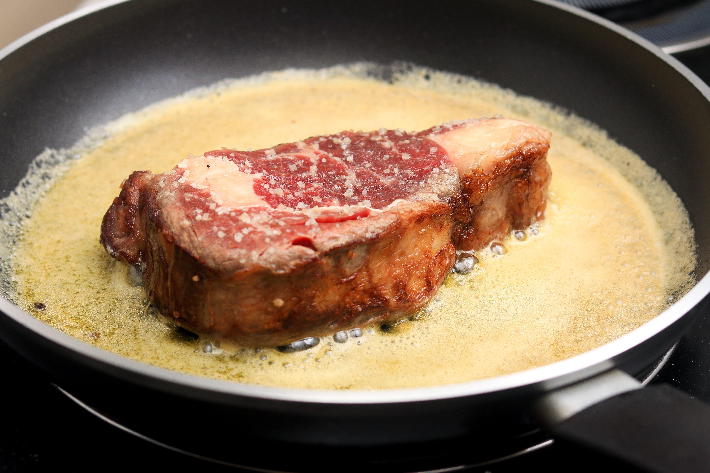 Basting ribeye in butter.