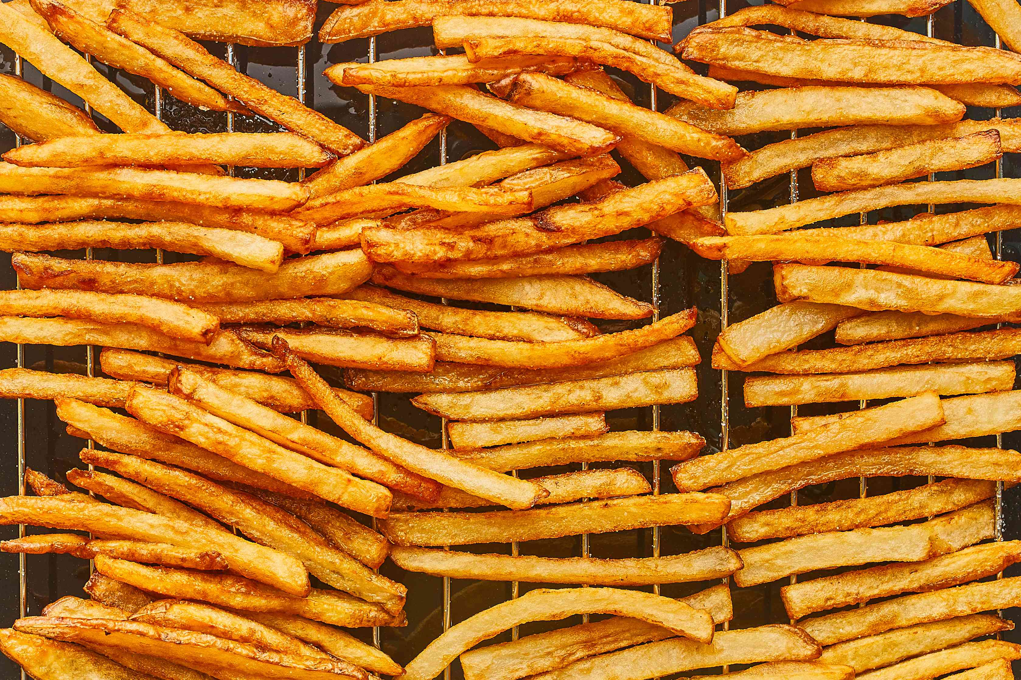 French fries draining on a rack
