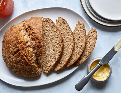 Traditional Irish wheaten bread on a plate with butter