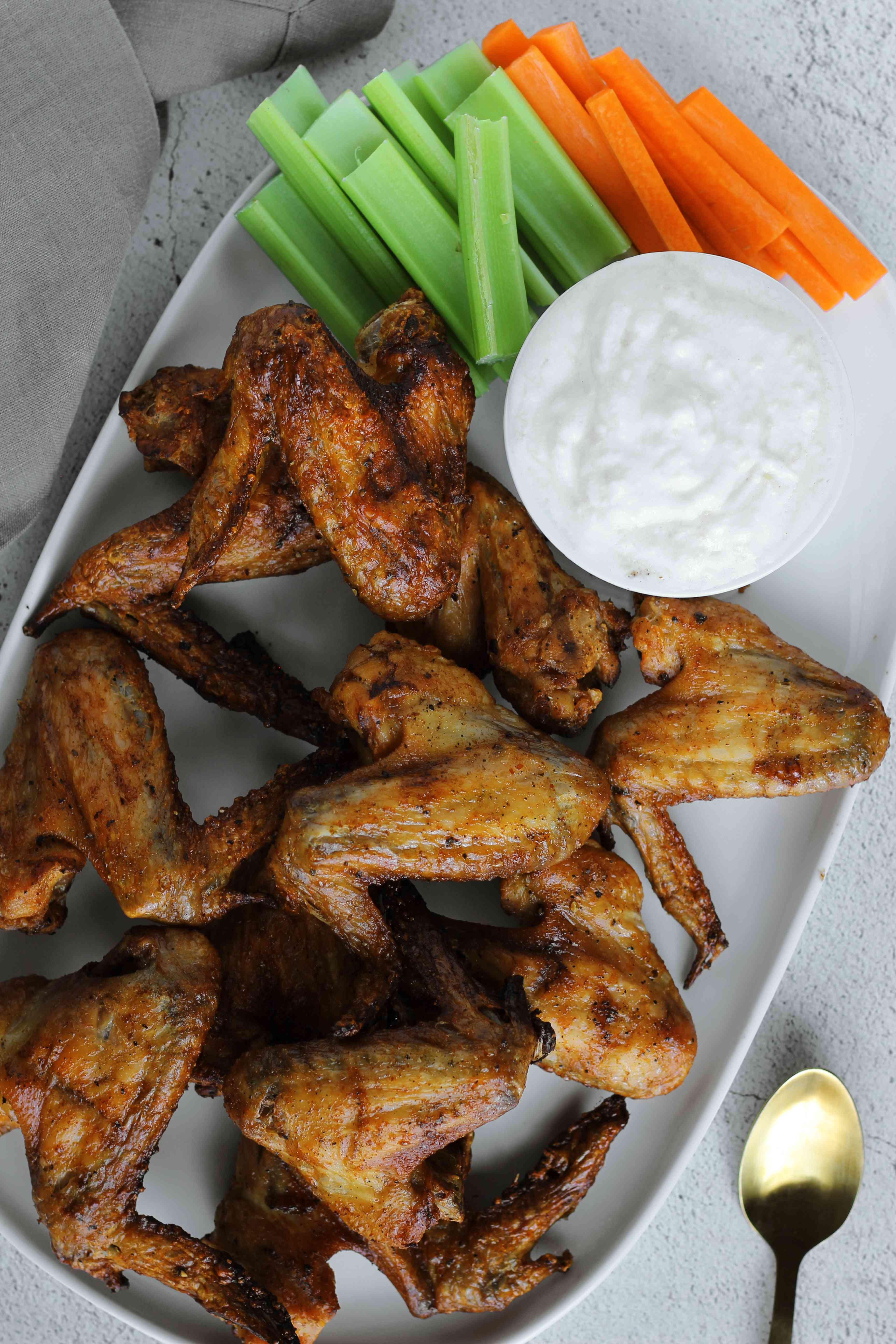 Salt and vinegar wings, dipping sauce, celery, and carrots