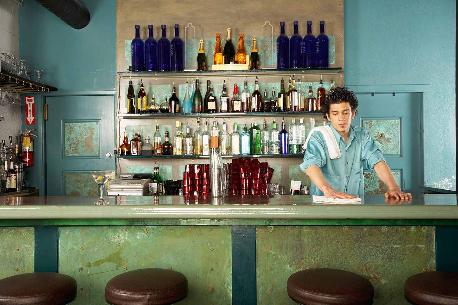 A bartender wiping down a counter