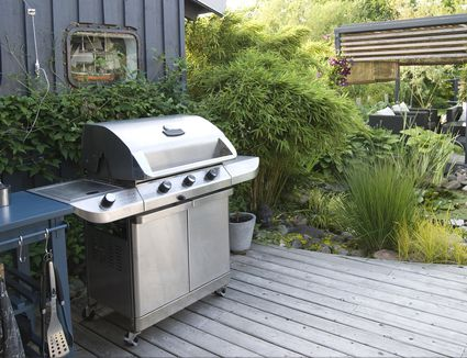 Stainless steel grill on patio