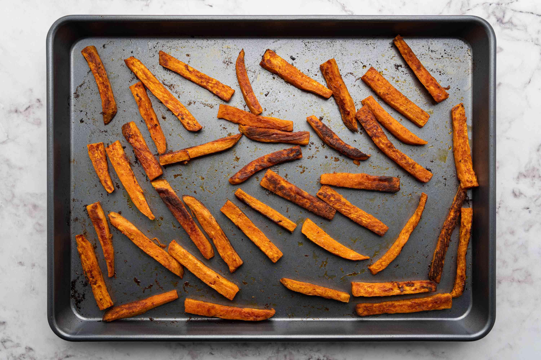 Baked Vegan Sweet Potato Fries on a baking sheet