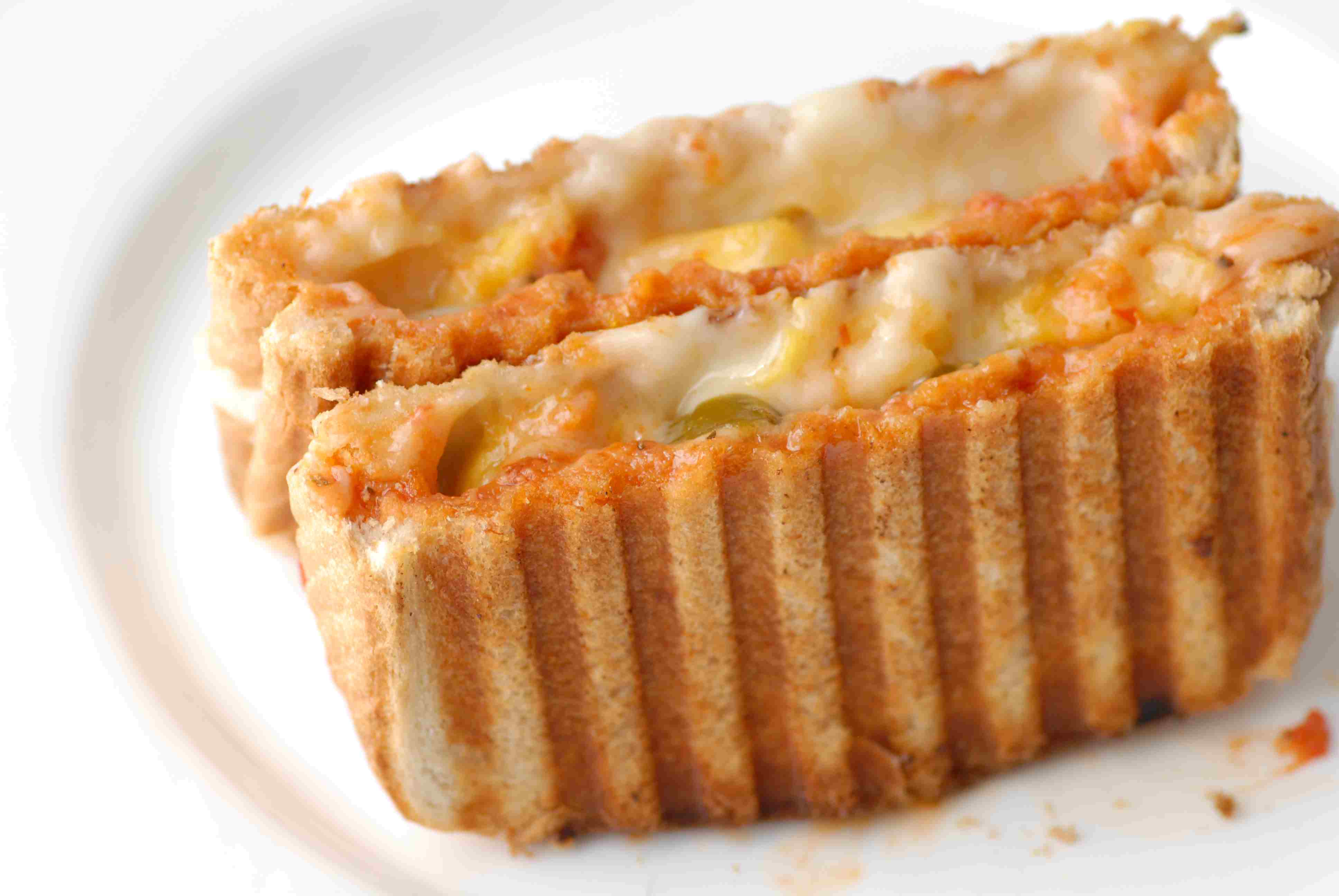 Panini press grilled cheese sandwich on a plate