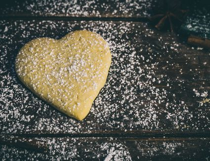 Close-Up Of Heart Shape Dough On Table