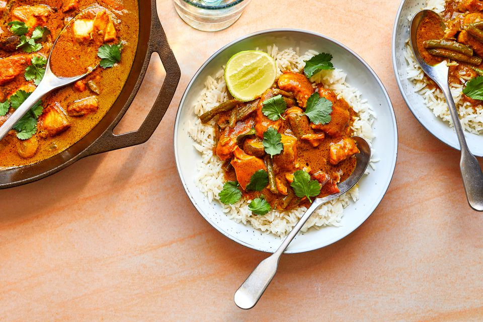Thai Fish Curry in a bowl with rice and lime