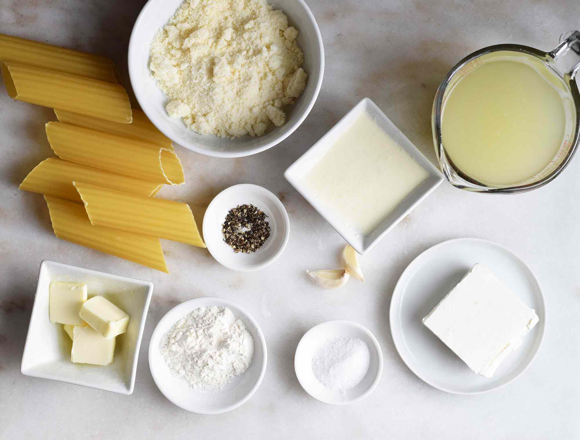 ingredients for Alfredo sauce on a marble board