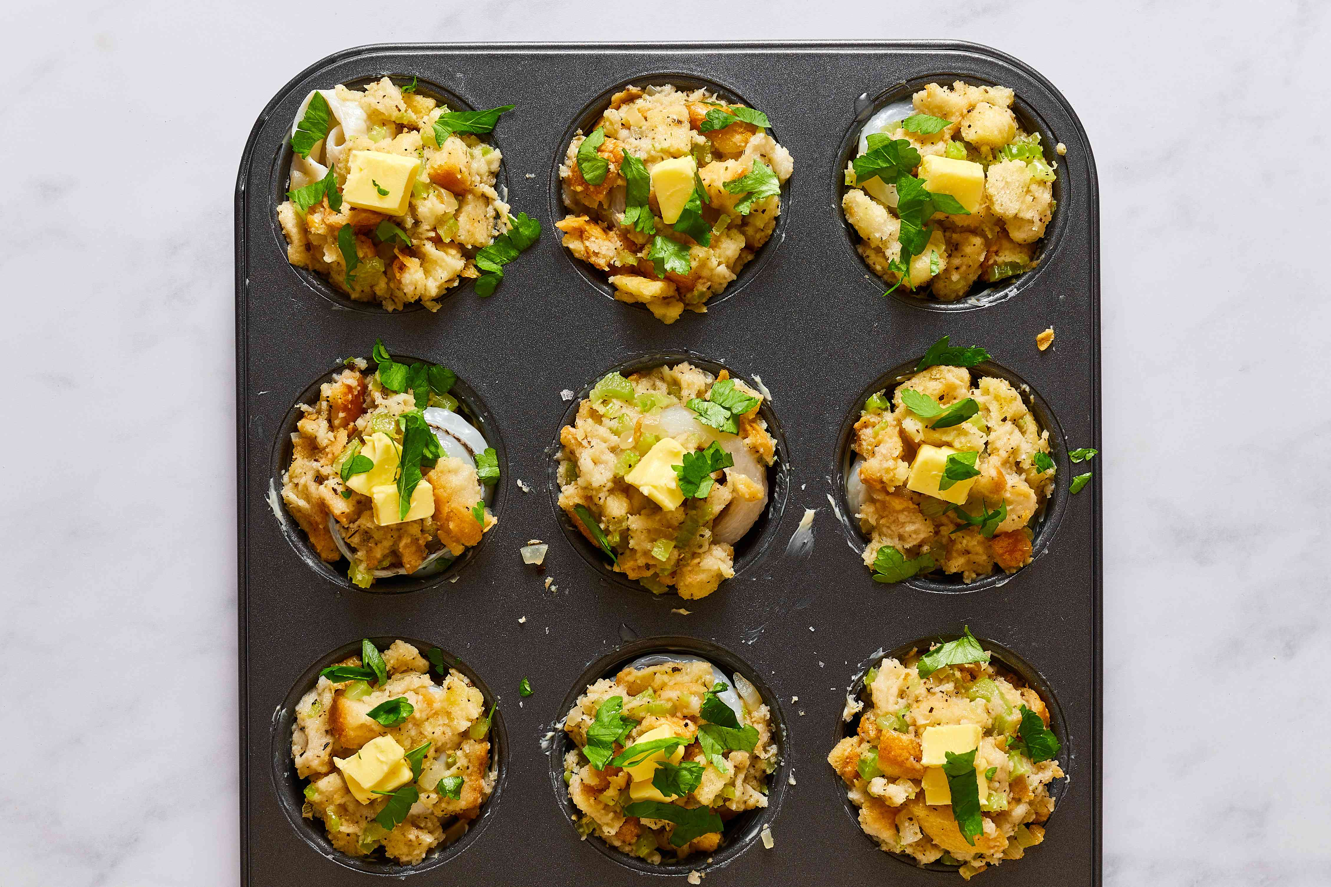 Sprinkle the stuffing in the muffin tins with chopped parsley