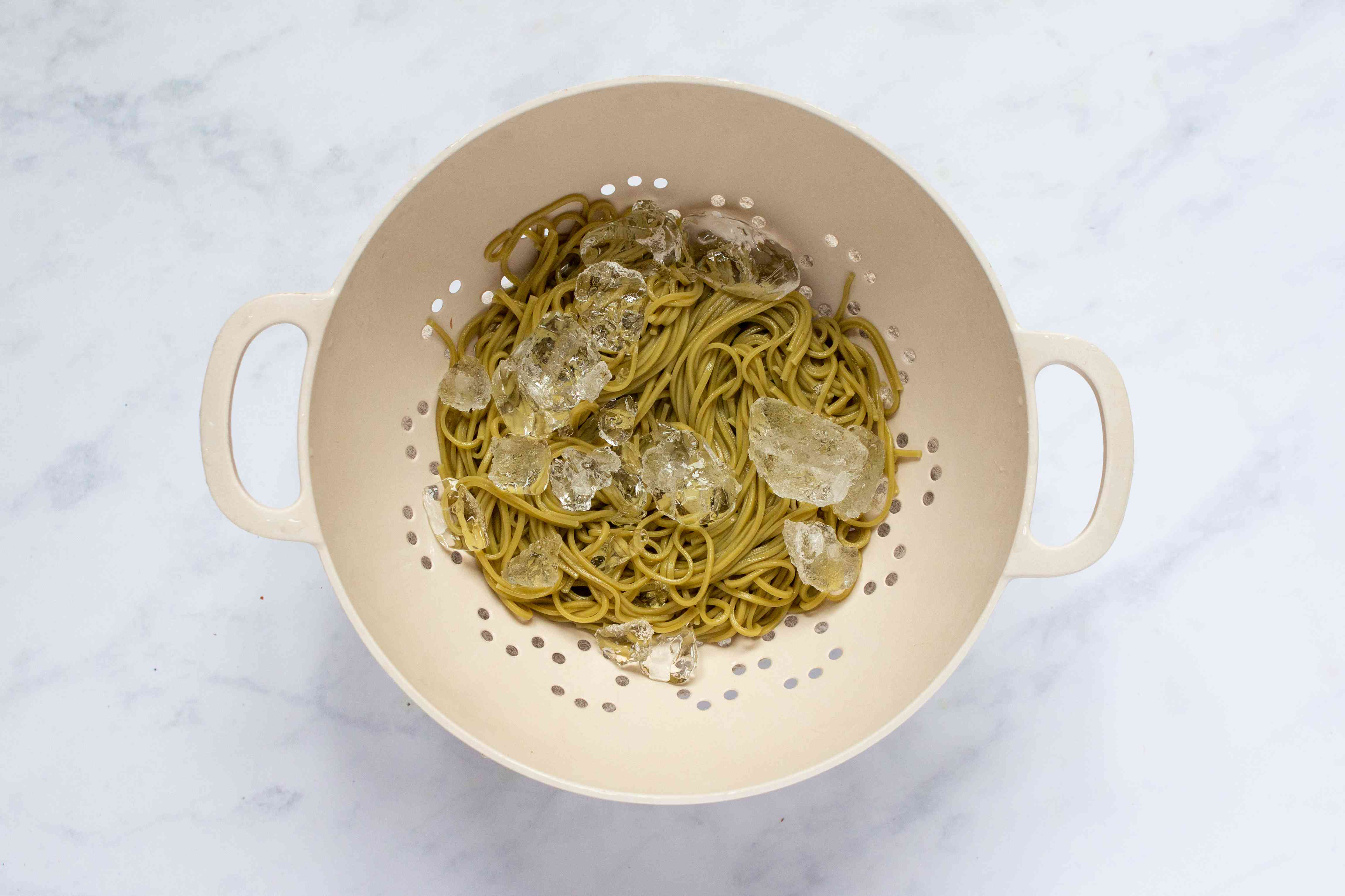 soba noodles in a colander with ice