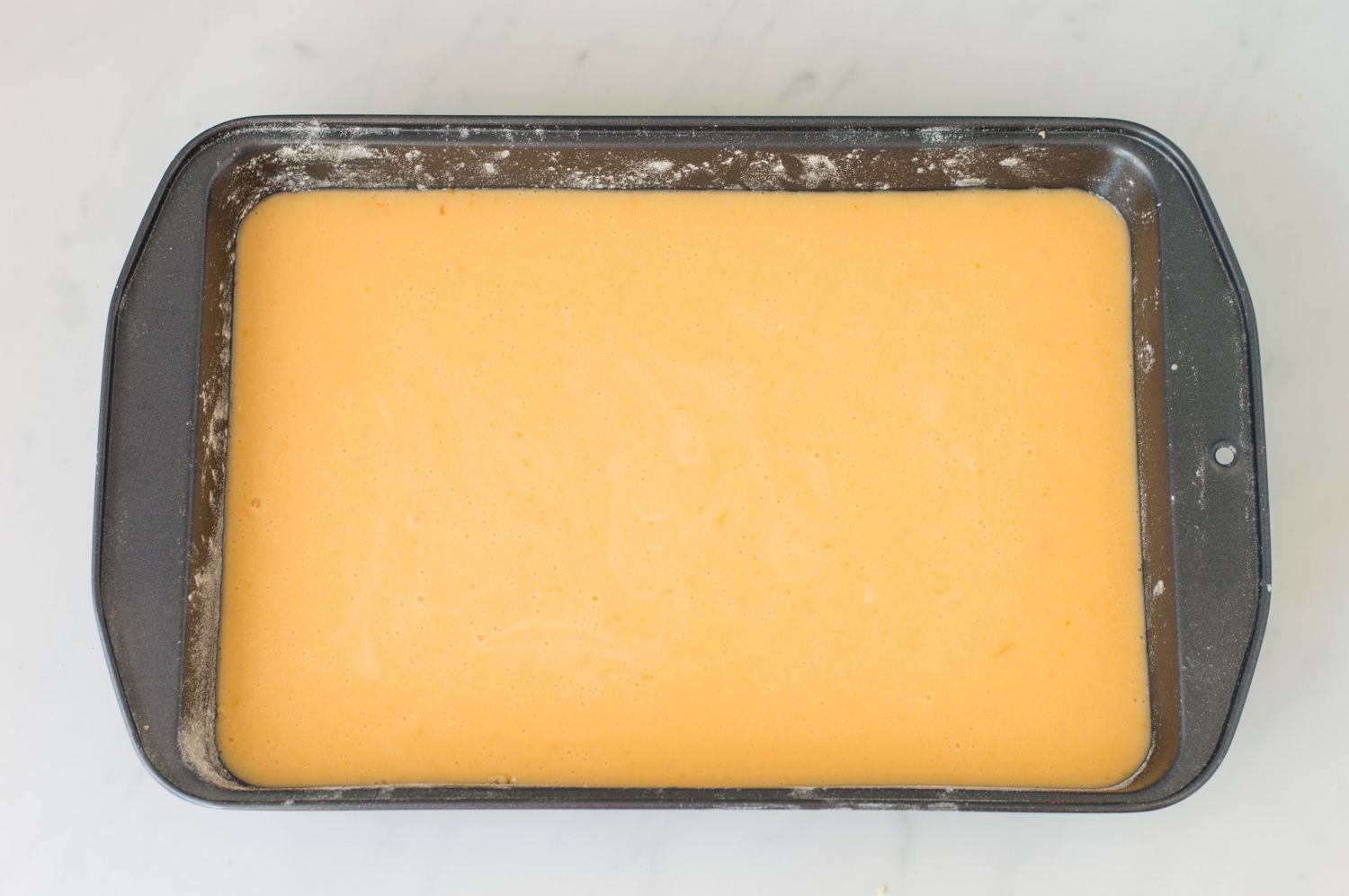 Cream cheese mixture poured over baking pan