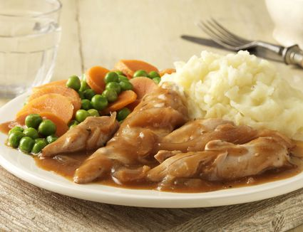 Chicken with gravy, mashed potatoes, peas, and carrots