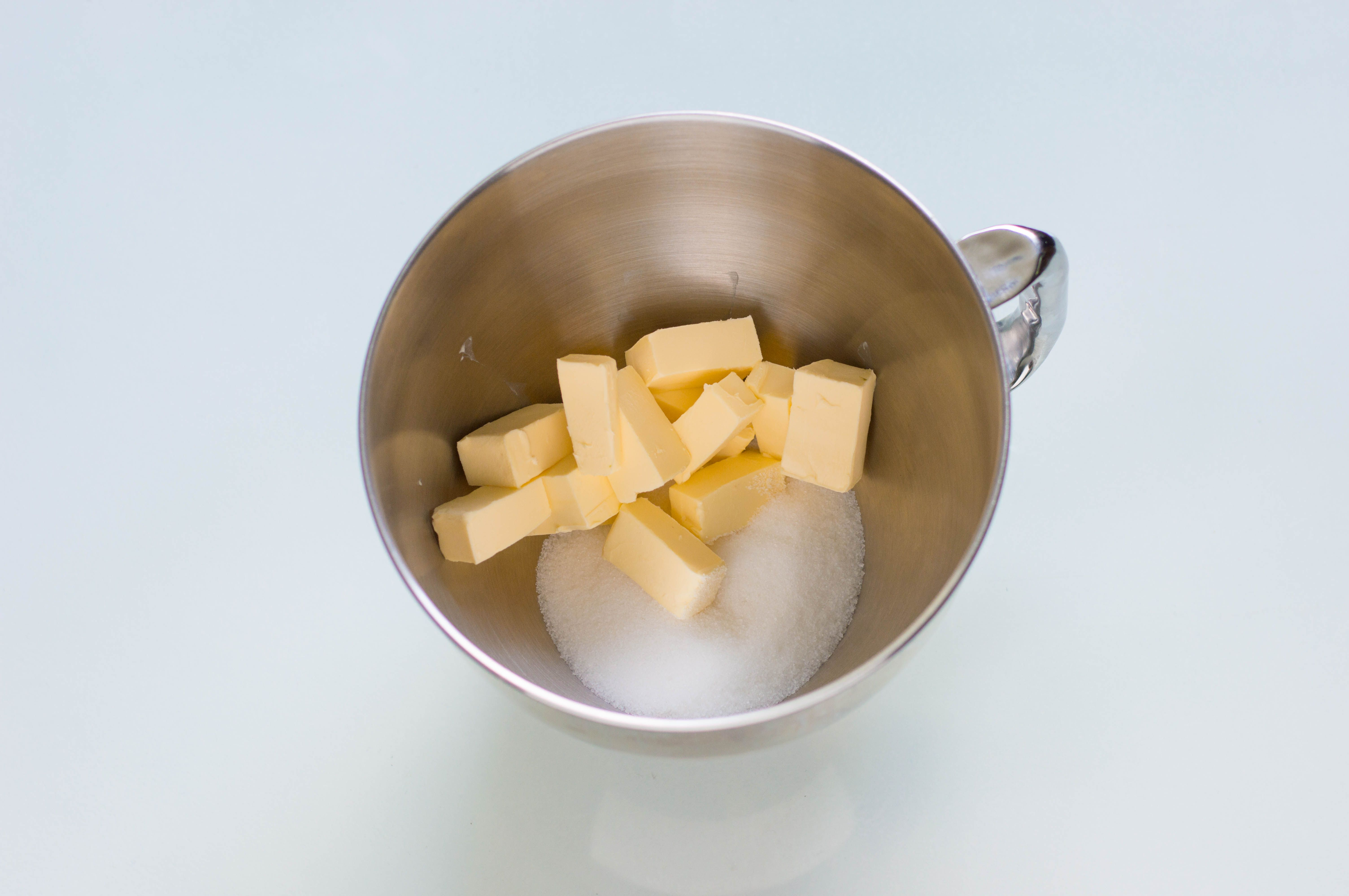 Combine butter and sugar in a mixing bowl