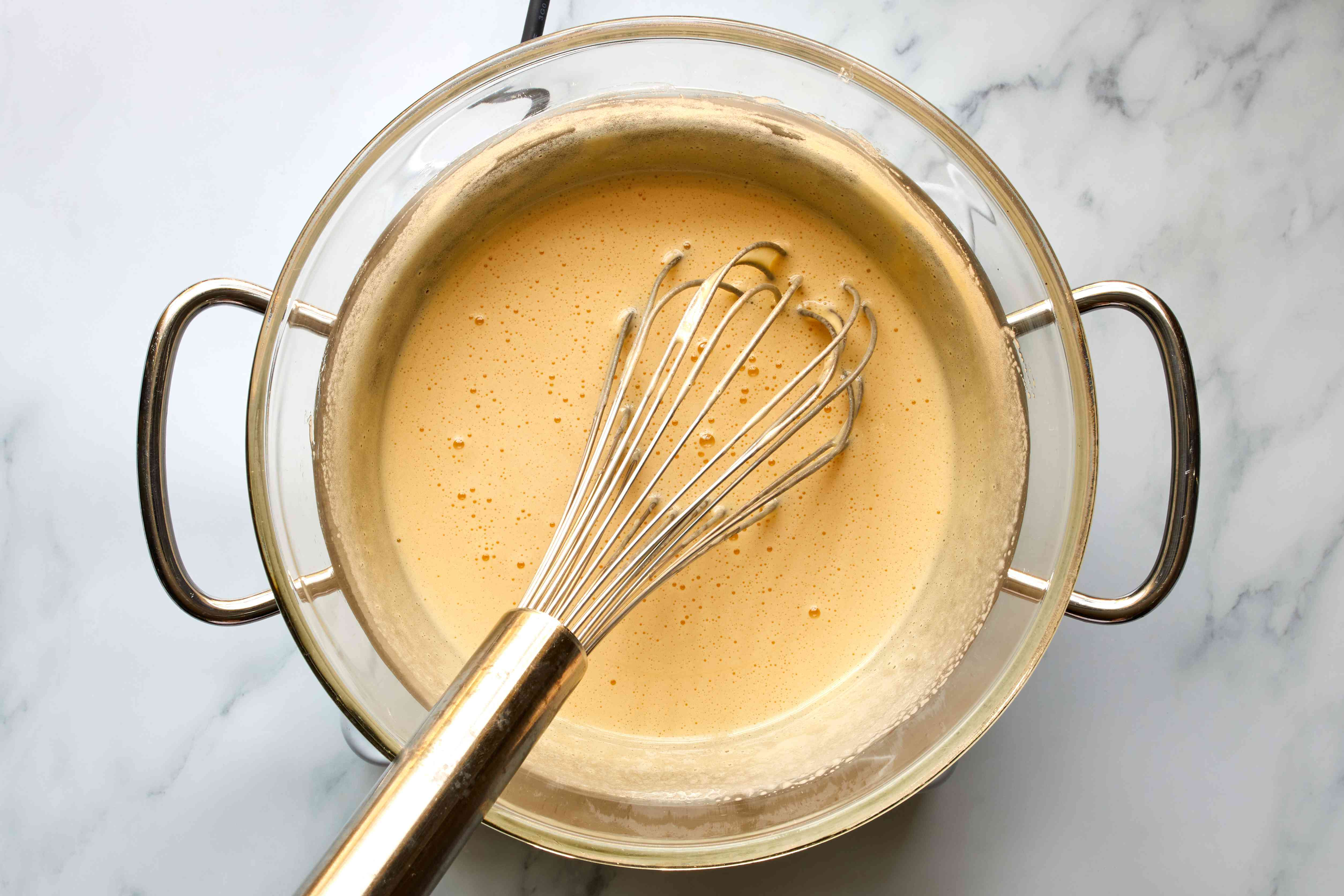 egg mixture on a double-boiler whisked