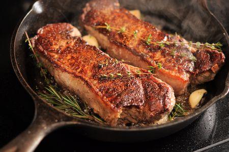 Strip Loin Steaks In A Cast Iron Pan