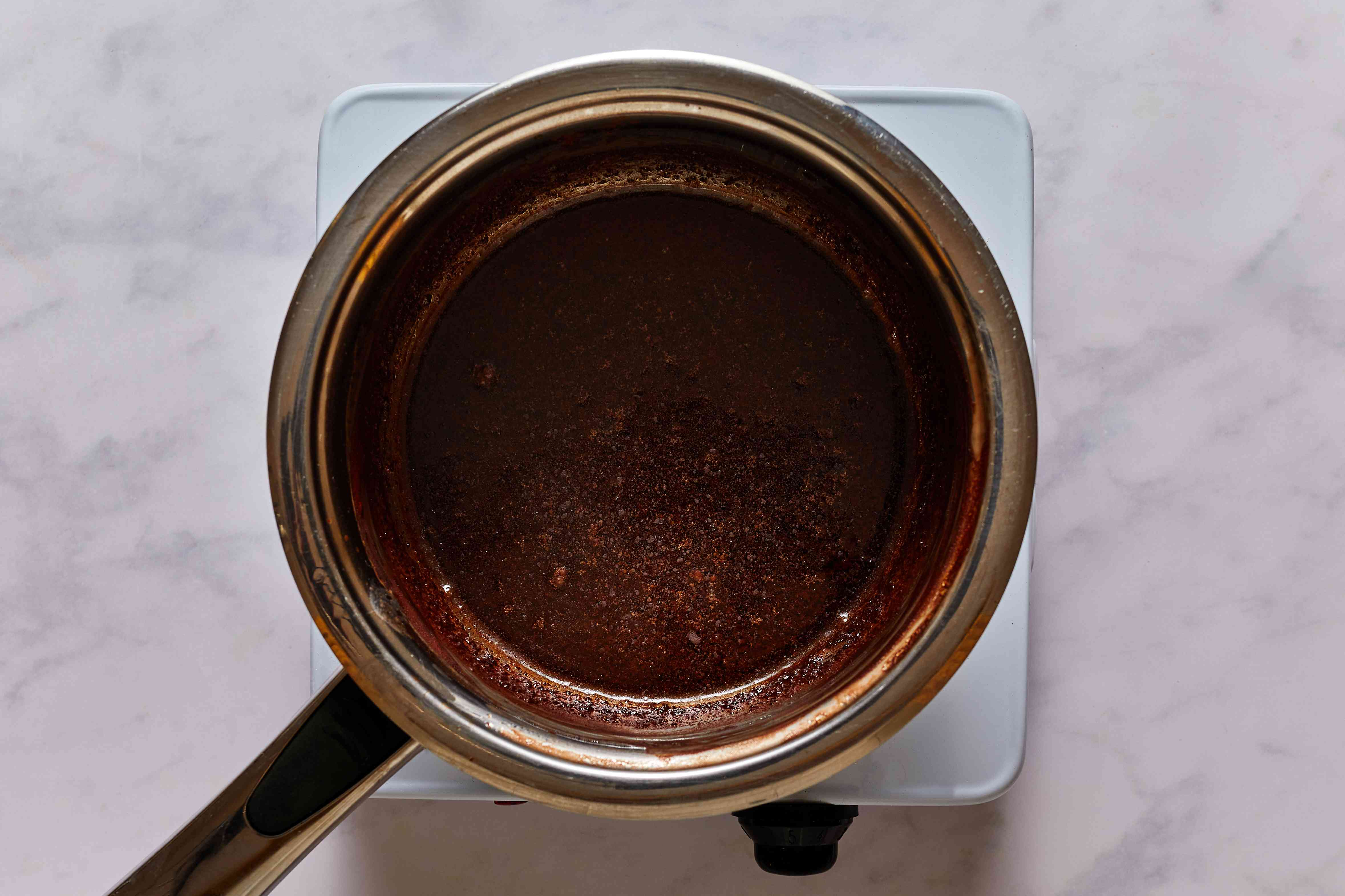 combining the butter, cocoa, and milk in a saucepan