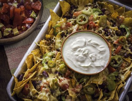 Baked Nachos Tortilla Chips with Salsa, Minced Meat and Jalapenos
