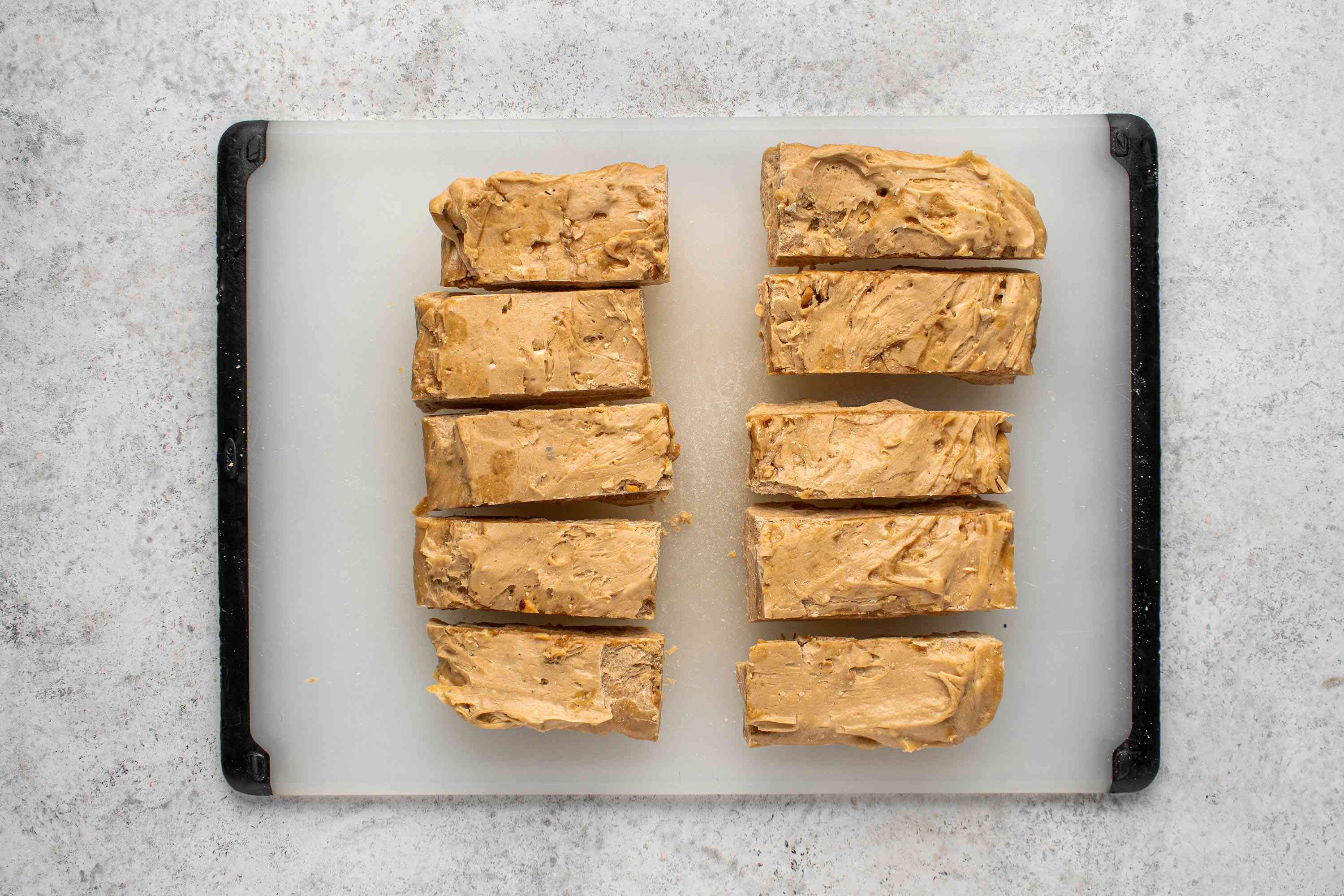 peanut butter candy pieces on a cutting board