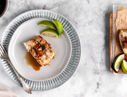 Easy Thai Grilled Fish Fillets on a white plate, lime wedges