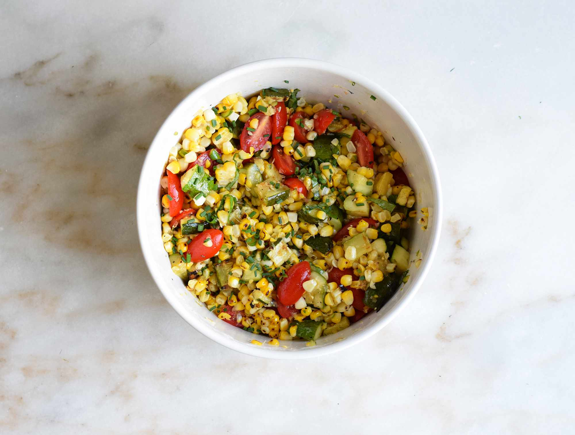 corn salad tossed in a bowl