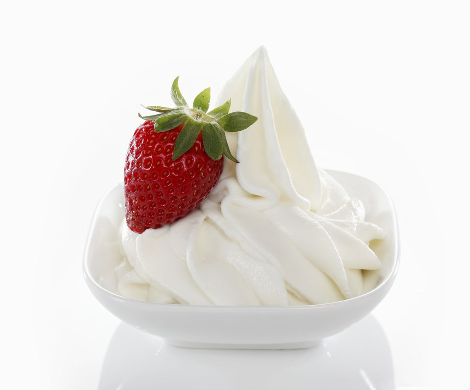 'Yogurt ice cream, garnished with fresh strawberries'