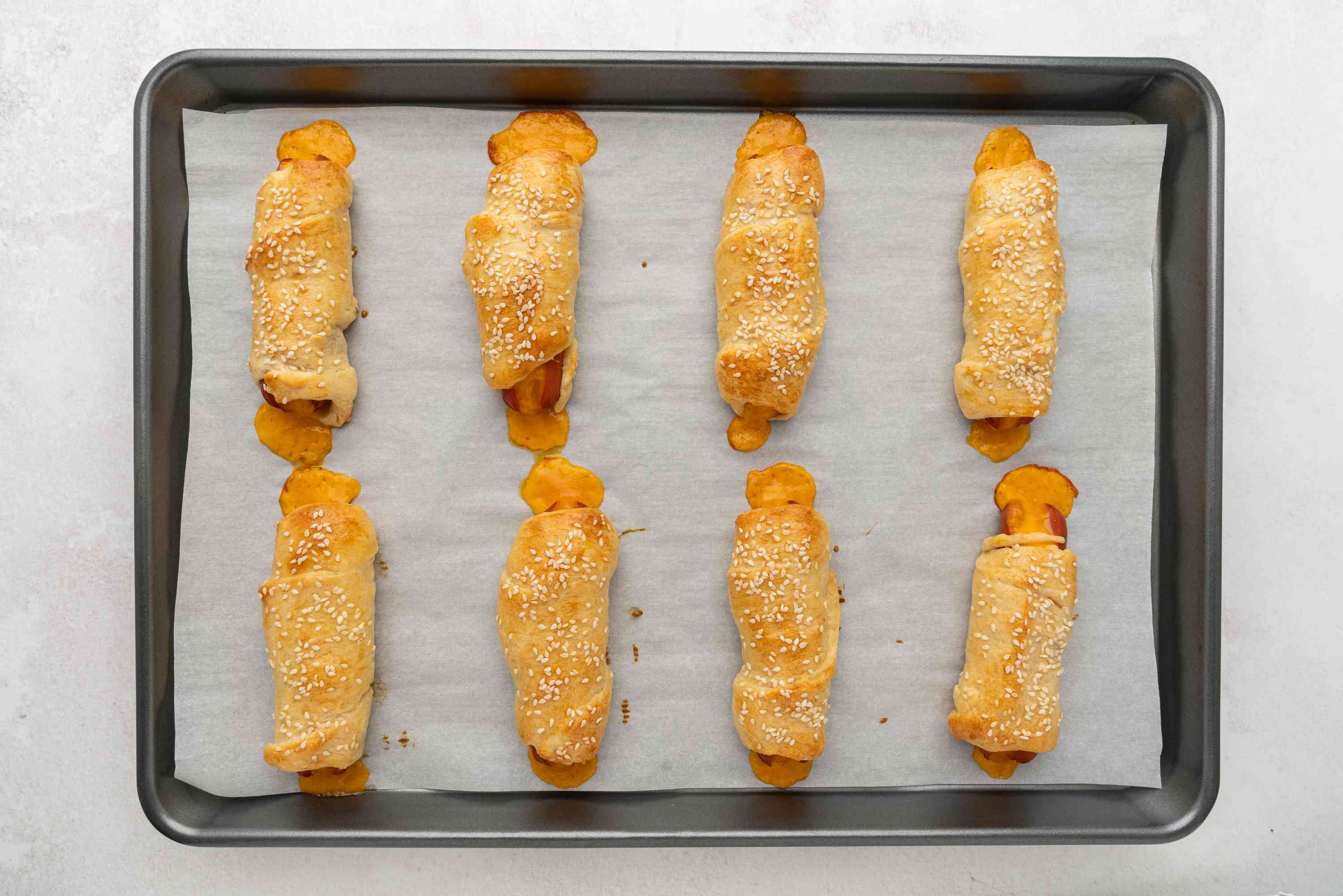 Baked Crescent Roll Pigs in a Blanket on a baking dish