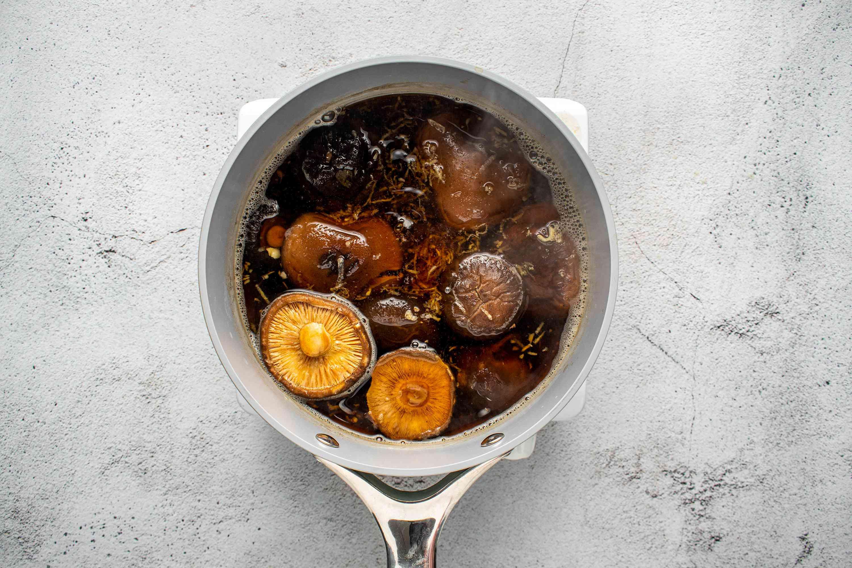 mirin, tamari, and ginger added to the dashi in the saucepan