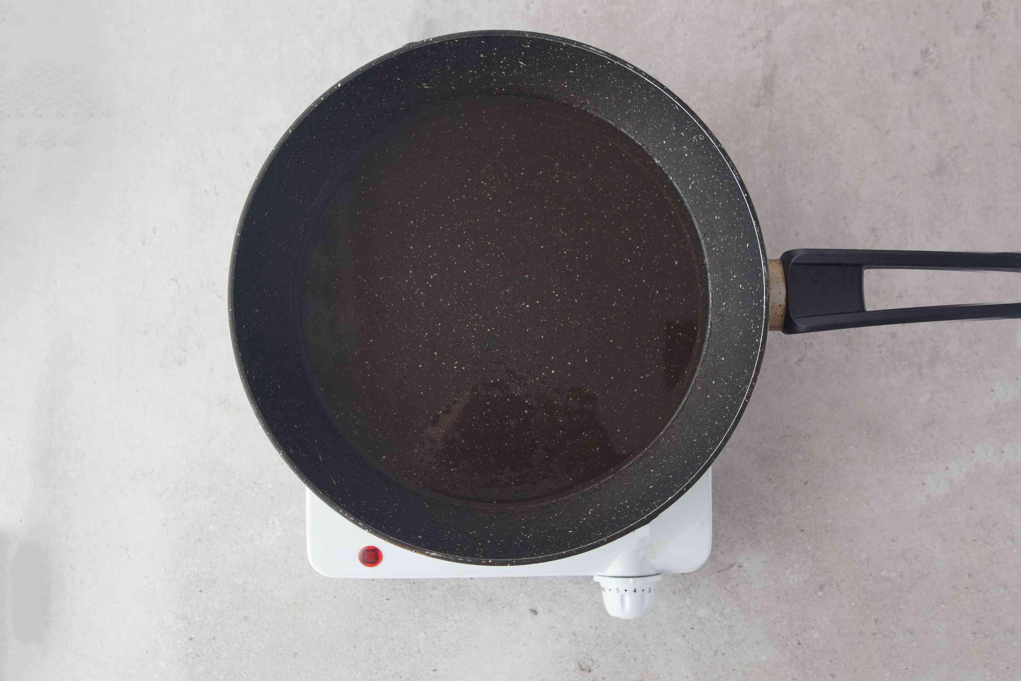 Heat oil in heavy-bottom pan
