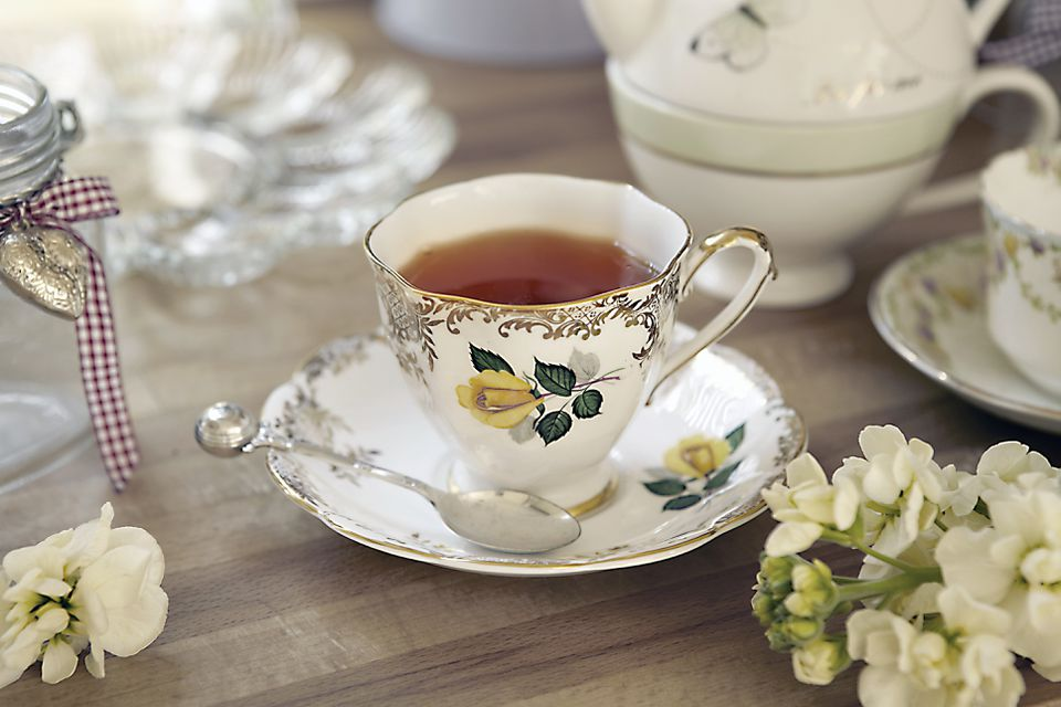 Quaint teacup and saucer on table